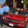 Vintage cars participating in The Great Race arrive in Lowell and park on Middle Street, on their way from Maine to Florida. Irene Jason and husband Barry Jason of Keller, Texas, got the first perfect daily score in the history of the event, driving in their 1966 Mustang. They've won The Great Race the last two years in a 1935 Ford. (SUN/Julia Malakie)
