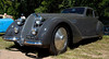 1938 Alfa Romeo Tipo 8C 2900B Berlinetta powered by a three-liter DOHC in-line eight with two valves per cylinder produced 180 bhp in a car that, despite being in this case 10 feet long, weighed just a hair over 1000 kg.<br /> <br /> Probably no sports car in the 30s was faster; they dominated the Mille Miglia in those years.<br /> <br /> This car won in 1947.