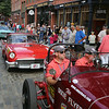Vintage cars participating in The Great Race arrive in Lowell and park on Middle Street, on their way from Maine to Florida. At front in a 1933 Ford Speedster are navigator Chris Millikin of Lake Hopatcong, N.J., and his father-in-law, driver Brian Lockwood of Newton, N.J. The car belongs to Millikin. (SUN/Julia Malakie)