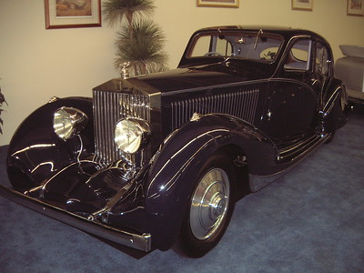 This is 2MS -at the Harrah's Imperial Car Collection in Vegas. Prior to this I last saw her in a private collectors home in Danville, in a gated community that shall remain unnamed.  Of the 1680 Phantom IIs, this is the only example that recieved coachwork from Figoni et Falaschi, one of the most sought after design houses for the period. Known for thier smooth, flowing designs, Figoni et Falaschi made this Rolls untypical of coachhwork found on other Phantoms. The lines of the car, especially at the rear distinguish it from any other Rolls-Royce.  The Prince of Nepal commisioned Figoni et Falaschi to create this unique example. The result was and still is a very elegant car that hides it enourmous size. The Phantom II was the largest chassis these coachbuilders had ever worked on!