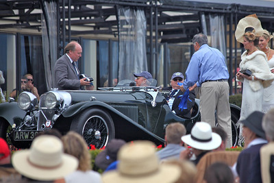 The 1935 Jaguar S.S. 90 Open Sports shown by Christian J Jenny, Thalwil, Switzerland on the ramp and receiving award from Mr Ratan Tata, owner of Jaguar Land Rover cars.  Entered in class N-1 Jaguar 75th Anniversary, Pebble Beach 2010 Concours d'Elegance