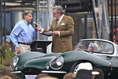 Mr. Ratan N Tata, Chairman of Tata Motors, owner of Jaguar Land Rover was on hand to present the new Jaguar Trophy which Tata has donated to the Pebble Beach Concours d'elegance.  Pebble Beach, CA August 15 2010.  The 1957 Jaguar XKSS #722 shown by The Petersen Automotive Museum, Los Angeles, California is on the stand.  The car was driven by Norman Dewis, the Jaguar works test driver for D type and XKSS cars.