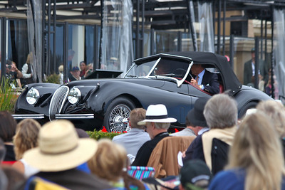 The 1953 XK120 shown by Frank and Steve Morton of Pebble Beach on the ramp at the 2010 Pebble beach Concours d'elegance.