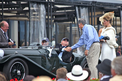 The 1935 Jaguar S.S. 90 Open Sports shown by Christian J Jenny, Thalwil, Switzerland on the ramp and receiving award from Mr Ratan Tata owner of Jaguar, Land Rover cars.  Entered in class N-1 Jaguar 75th Anniversary, Pebble Beach 2010 Concours d'Elegance