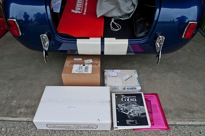 Also packed are spare paint in both colors (brown box), spare electric fuel pump and filters, and various tools (big white box), spare AN fittings (little white box), Contemporary Cobra manual (binder), and instruction manuals for MSD ignition, distributor, etc (red folder). California Car Cover is in grey bag in the trunk.