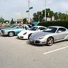 Porsche Caymans, Cadillac DeVille, and a Cadillac Eldorado