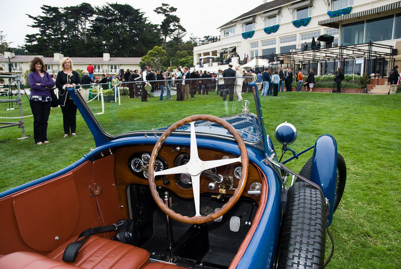 An old Bugatti being marveled at by bystanders...