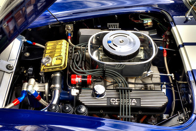 This is the famous Ford 428FE Cobra Jet motor. It has been completely rebuilt from the block up with all new bearings, balanced, blueprinted and precisely assembled with combination of grade 8 and ARP bolts, and carefully torqued to factory specs. The Cobra Jet is an improvement over the 428FE Police Interceptor motors that were used alternately with the 427FE side-oiler in original 427 Cobras. It is the highly desirable motor for those who want awesome power, streetability and authenticity in their 427 Cobra.