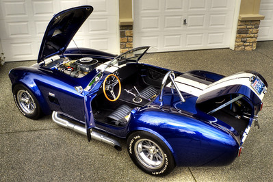 Dedicated attention to detail is evident in engine bay, cockpit, trunk, and exterior. This Cobra also has a custom black soft convertible top and side curtains.