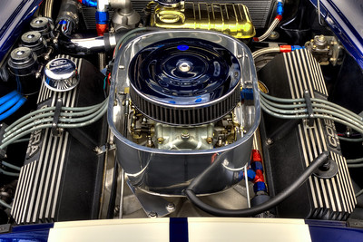 Holley 750 cfm double-pumper carburetor with manual choke. Stelling & Hellings air cleaner with K&N filter. Polished aluminum 'turkey pan' cold air box