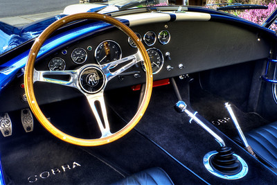 """Moto-Lita laminated mahogany 15"""" SS-spoked steering wheel with AC hub emblem. AC cast aluminum foot pedals. MSD 6-AL ignition visible under dash. Wipers and wiper mechanism installed with electric motor (not wired)."""