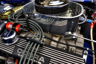 Cobra LeMans finned aluminum valve covers, black wrinkle finish. Holley fuel pump & pressure regulator, recirculating fuel system, Kinsler filter. Custom fabricated black nylon wire looms keep MSD plug wire neatly routed from MSD Pro-Billet distributor to spark plugs.