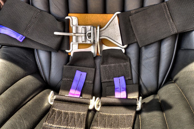 """Heavy duty 4"""" nylon webbing seat belts, with dual shoulder straps (all anchored to frame), have period aircraft hardware latching mechanism with leather pads."""