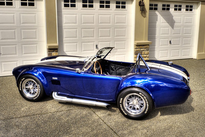 Tube headers and 427 SC side pipes with aluminum ceramic coating. Painted aluminum side vent louvers.
