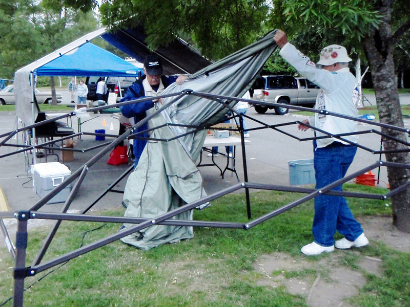 Set up began at 600am sharp. Jim Brossard and Bob Ormsby assemble this shelter which sure came in handy during the morning drizzle.