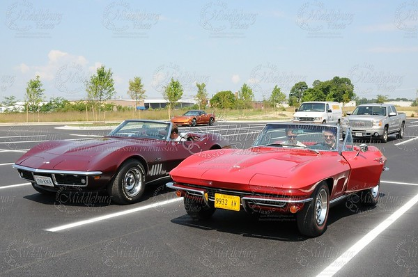 Corvetts in the parking lot! This car was used in the ad for the corvette show.