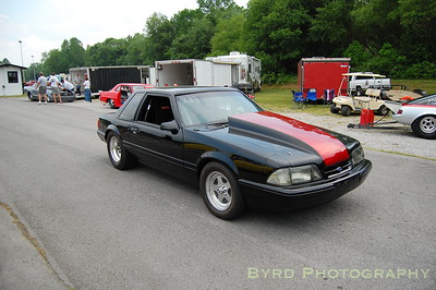 Clean Mustang coupe rolling through the pits.
