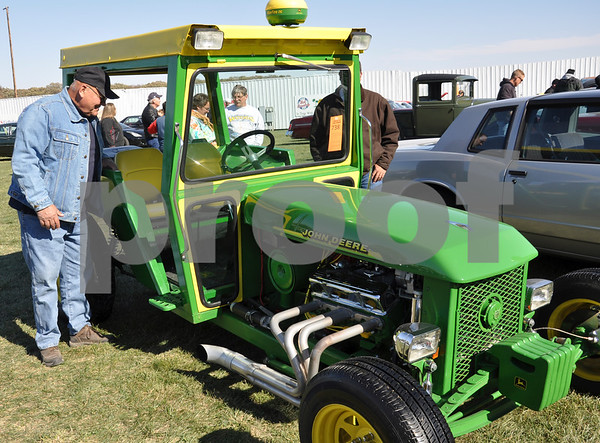 "-Messenger photo by Joe Sutter<br /> <br /> Gene Brass, Buffalo Center, designed this ""tractor"" pretty much from scratch. Many of the pieces do in fact come from a John Deere tractor. The weights in the front are made of wood. Despite all the peculiar stylings, Brass made sure to keep the car street legal."