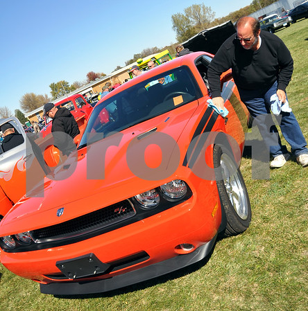 -Messenger photo by Joe Sutter<br /> <br /> Jeb Ball of Jefferson polishes his 2010 Dodge Challenger. Ball comes to the Cruise to the Woods every year.
