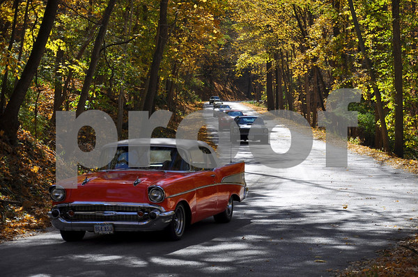 -Messenger photo by Joe Sutter<br /> <br /> Classic cars of all kinds cruise through the woods at Dolliver Park late Sunday morning. Around 800 cars took place in the cruise, which went from Stratford through Dolliver and Coalville and ended at the Webster County Fairgrounds.