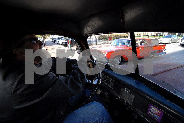 -Messenger photo by Hans Madsen<br /> <br /> Wayne Lussman, of Fort Dodge, enjoys the view from the cab of the many other vehicles taking part in the annual Cruise to the Woods car show Shag the Drag event in downtown Fort Dodge. Lussman was driving his 1946 Ford pickup truck.
