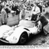 Le Mans 1961: Co-driver Bill Kimberly enjoys the ride while Briggs and Alfred push their eighth-place Maserati Birdcage past John Baus to parc ferme. BSC Collection