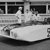 """24 Hours of Le Mans, 1950. Pit scene, Car Number 2, The Cadillac """"LE MONSTRE"""", (Briggs Cunningham and Phil Walters, co-drivers); Briggs Cunningham (seated in car), Phil Walters (dark shirt/trousers, standing at left side of car). (Photo credit: Smith Hempstone Photograph Collection, Revs Institute)"""