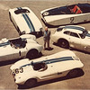 Briggs Cunningham with some of his racecars. The Cadillac known as Le Monstre is at the top right. (The Collier Collection)
