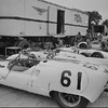 USAC Pacific Grand Prix, Monterey, CA, 1962. Car number 61 and number 63, Briggs Cunningham's Cooper Monaco T57 parked in front of the transporter. (Photo credit: Fred Pardini Photograph Collection, Revs Institute)