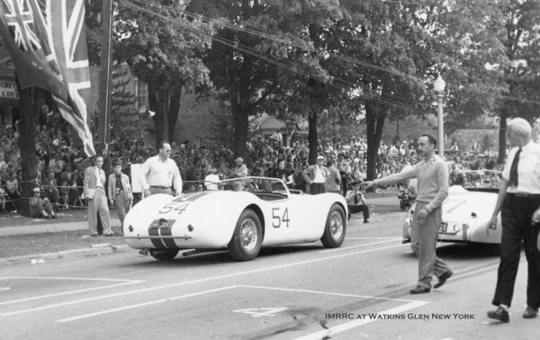 Photo Above: John Fitch lines up in the 10th grid spot for the Watkins Glen Grand Prix, September 15, 1951. Helping grid cars are George Weaver (pointing) winner of both previous races that day.