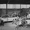 """24 Hours of Le Mans, 1950. Garage scene, left to right: Car Number 3, the Cadillac Series 61 """"PETIT PATAUD"""", (Sam Collier and Miles Collier, co-drivers); Car Number 2, the Cadillac """"LE MONSTRE"""", (Briggs Cunningham and Phil Walters, co-drivers). (Photo credit: Smith Hempstone Photograph Collection, Revs Institute)"""