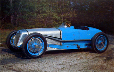 DELAGE (Grand Prix Race Car): Postcard, 4x6. Front of card is photograph showing three-quarter frontal view of blue and silver Delage Grand Prix race car, parked in outdoor setting. Reverse side has brief description and is unused. Postcard was produced and sold by the Briggs Cunningham Automotive Museum from a car in the collection. I.D. #37635. Copyright 1972.