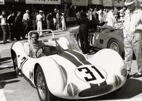 Sebring, March 1961: Briggs Cunningham at the wheel of his Tipo 60, now painted in its American racing colors. Bill Kimberly is kicking the front tire. They finished 18th due to exhaust manifold problems. Photo: Al Bochroch. (www.themaseraticl...)