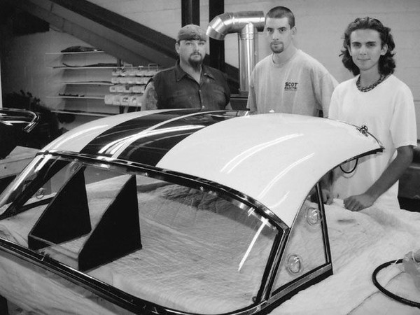 "1960 Chevrolet Corvette Hardtop Restoration<br /> Here's the completed top, ready to head out to Corvettes at Carlisle to be reunited with the 1960 Briggs-Cunningham No.3 Le Mans car. Glassworks' Joe Tustin, Bryan Benson, and Matt Kokolis (left to right) stand behind a job well done. Source: <a href=""http://www.vetteweb.com/tech/vemp_0203_c1_corvette_hardtop_restoration/photo_46.html"">http://www.vetteweb.com/tech/vemp_0203_c1_corvette_hardtop_restoration/photo_46.html</a>"