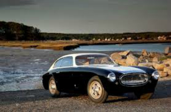"This Cunningham C3 is the first of the mere handful of Briggs Cunningham built cars designed for the road. This Vignale-bodied beauty, chassis 5206, is often referred to as ""the prototype"", being the first of the 20 coupes assembled and its unique stance (it's 2 inches shorter than the others, and curved side glass (the other 19 built had flat windows). This car was originally owned by Brigg's friend Carl Kiekhaefer, the owner of Mercury Marine and prominent NASCAR team owner."
