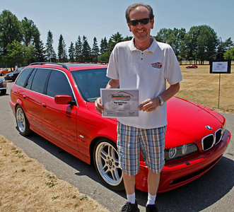 Jim Prihoda smiles with his award-winning 2001 BMW 525i Touring during the inaugural DeutscheMarques German auto event at the Gilmore Car Museum on July 7. The event was sponsored by Zeigler BMW, Hayes Mercedes-Benz and Delta Porsche (Bradley S. Pines / BSPines@gmail.com)