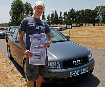 Tom Woodburn of Portage smiles with the awards his 2005 Audi A4 won, with S4 brakes, Vogtland coils and A4 wheels, during the inaugural DeutscheMarques German auto event at the Gilmore Car Museum on July 7. The event was sponsored by Zeigler BMW, Hayes Mercedes-Benz and Delta Porsche (Bradley S. Pines / BSPines@gmail.com)