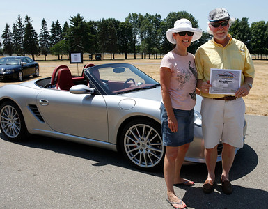 Kathy and Mark Bonnema of Grand Haven, holding their Best 21st Century Porsche Award, smile with their 2008 Porsche Boxter S, an RS 60 Sypder, during the inaugural DeutscheMarques German auto event at the Gilmore Car Museum on July 7. The couple is a member of the WMR of the PCA. The event was sponsored by Zeigler BMW, Hayes Mercedes-Benz and Delta Porsche. (Bradley S. Pines / BSPines@gmail.com)