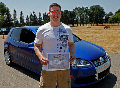 Troy Cox smiles with his award-winning 2008 Volkswagen R23, the 920th of only 5,000 made, during the inaugural DeutscheMarques German auto event at the Gilmore Car Museum on July 7. The event was sponsored by Zeigler BMW, Hayes Mercedes-Benz and Delta Porsche. (Bradley S. Pines / BSPines@gmail.com)