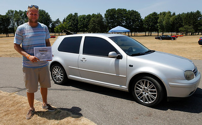 Andrew Verschure smiles with his award-winning Volkswagen GTI  during the inaugural DeutscheMarques German auto event at the Gilmore Car Museum on July 7.  The event was sponsored by Zeigler BMW, Hayes Mercedes-Benz and Delta Porsche. (Bradley S. Pines / BSPines@gmail.com)