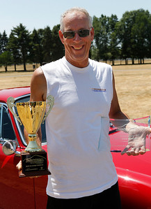 Terry Schieble of Portage smiles in front of his 1967 Porsche 911S after being awarded the Best in Show Delta Porsche Cup during the inaugural DeutscheMarques German auto event at the Gilmore Car Museum on July 7. Schieble's name will be the first engraved on the Delta Porsche Cup which will be on display at the Grand Rapids dealership, the exclusive Porsche sponsor of DeutscheMarques. Schieble is a longtime Porsche Club of America member and is currently the West Michigan Region's chief driving instructor. The event was sponsored by Zeigler BMW, Hayes Mercedes-Benz and Delta Porsche. (Bradley S. Pines / BSPines@gmail.com)