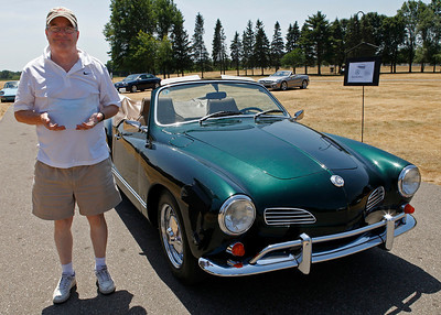 William Chapple of Marshall smiles in front of his classic 1968 Volkswagen Karmann Ghia, which was judged Best in Show Volkswagen during the inaugural DeutscheMarques German auto event at the Gilmore Car Museum on July 7. DeutscheMarques will be an annual gathering of German cars, owners and enthusiasts at the museum in Hickory Corners.  The event was sponsored by Zeigler BMW, Hayes Mercedes-Benz and Delta Porsche. (Bradley S. Pines / BSPines@gmail.com)