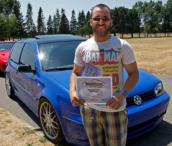 Greg Calderon smiles with the Best Daily Driver Volkswagen award won by his 2003 20th Anniversary VW GTI, featuring coilovers, a hybrid F23 turbo, xenon headlights, during the inaugural DeutscheMarques German auto event at the Gilmore Car Museum on July 7. The event was sponsored by Zeigler BMW, Hayes Mercedes-Benz and Delta Porsche (Bradley S. Pines / BSPines@gmail.com)