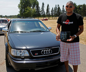 Joel Phillips of Kalamazoo smiles in front of his 1995 Audi S6, judged Best in Show Audi during the inaugural DeutscheMarques German auto event at the Gilmore Car Museum on July 7. DeutscheMarques was a gathering of all German cars and will be an annual event at the museum.  (Bradley S. Pines / DeutscheMarquesAG.com)
