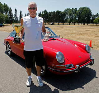 Terry Schieble of Portage smiles in front of his 1967 Porsche 911S after being awarded the Best in Show Delta Porsche Cup during the inaugural DeutscheMarques German auto event at the Gilmore Car Museum on July 7. Schieble's name will be the first engraved on the Delta Porsche Cup will be on display at the Grand Rapids dealership, the exclusive Porsche sponsor of DeutscheMarques. Schieble is a longtime Porsche Club of America member and is currently the West Michigan Region's chief driving instructor. (Bradley S. Pines / DeutscheMarquesAG.com)