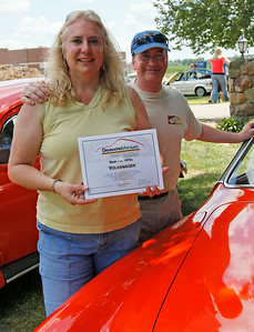 Lori and Roger May of East Lansing, Michigan, smile with their 1973 Karman Ghia, winner of the Best of the 1970s VW award. (Brad Pines / DeutscheMarques Auto Group)