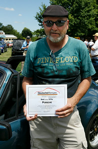 Jerry Broersma of Grand Rapids, a WMR PCA member, smiles with the Best of the 1970s award given to his 1979 Porsche 911SC.