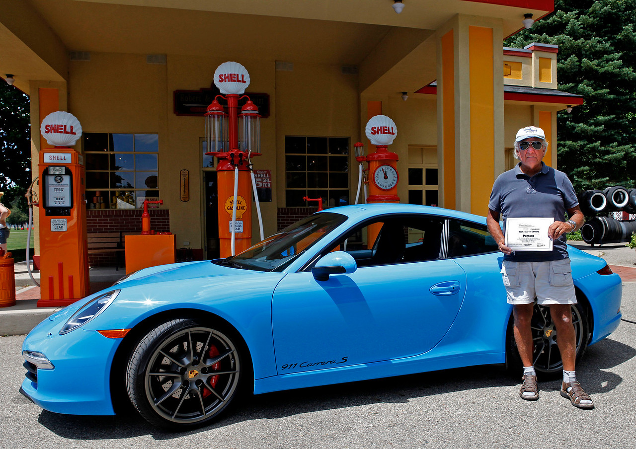 Jack Hartman, of Portage, Michigan, had his 2013 Carerra S, painted in a brilliant Riviera blue, named Best of the 21st Century.