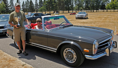 Jon and Jan Smucker of Goshen, Indiana smiles in front of their 1970 Mercedes-Benz 280SL, judged Best in Show Mercedes-Benz during the inaugural DeutscheMarques German auto event at the Gilmore Car Museum on July 7. Smuckers'  names will be the first engraved on The Orrin B. Hayes Mercedes-Benz Cup, which will be on display at the Kalamazoo dealership, the exclusive Mercedes-Benz sponsor of DeutscheMarques.  (Bradley S. Pines / BSPines@gmail.com)