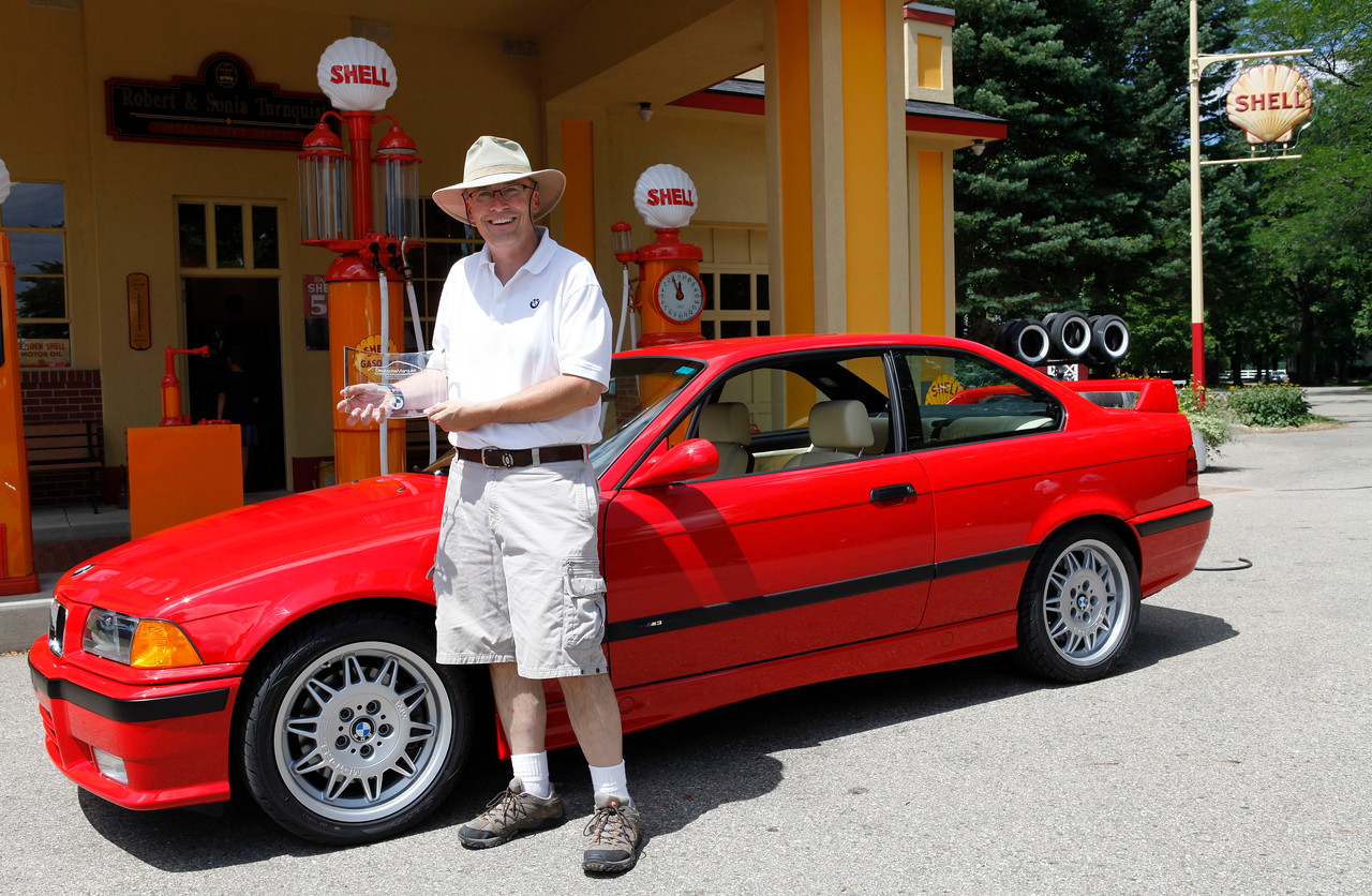 Andrew Baer displays the Best-in-Show BMW trophy in front of his 1995 M3 coupe at the Gilmore Car Museum. Baer's name is also engraved upon the BMW cup displayed in the Sharpe BMW showroom in Grand Rapids, Michigan. (John A. Lacko / lackophoto.com)